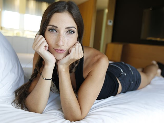 Hot French Date lying on bed with very sexy eyes